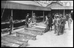 Temporary morgue in Queenstown<br>                    of the Lusitania victims.